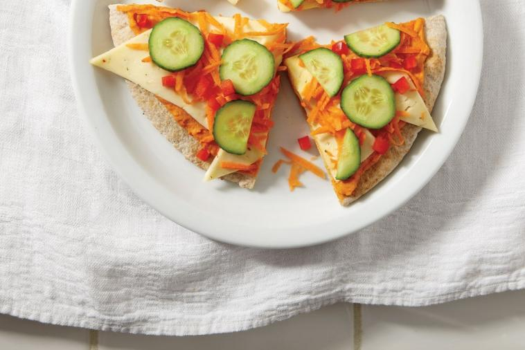 cold vegetable pizza with hummus and havarti