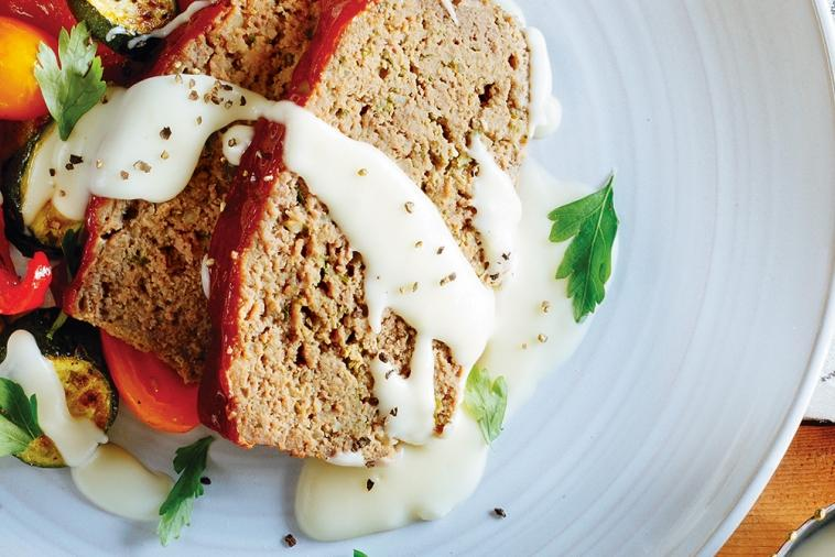 homestyle meatloaf with roasted vegetables cheese sauce